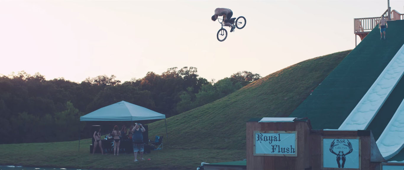 Bike jump into lake in Texas BSR Cable Park